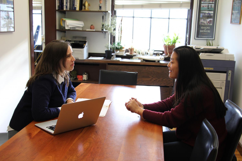 Upper School Dean Emily Gardiner consults with Maggie Perlman '17.