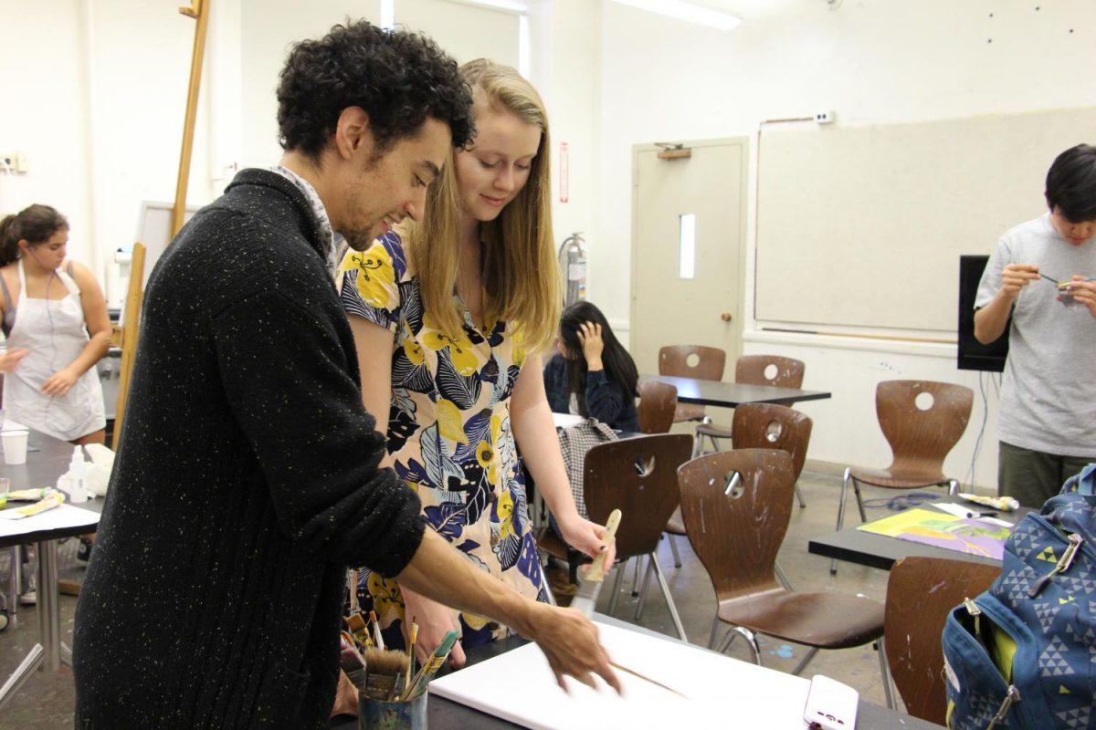 Art teacher Daniel Herwitt instructs senior Esme Graham.
