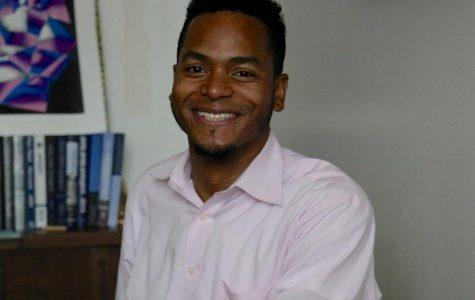 New Upper School Dean Runako Taylor in his office.