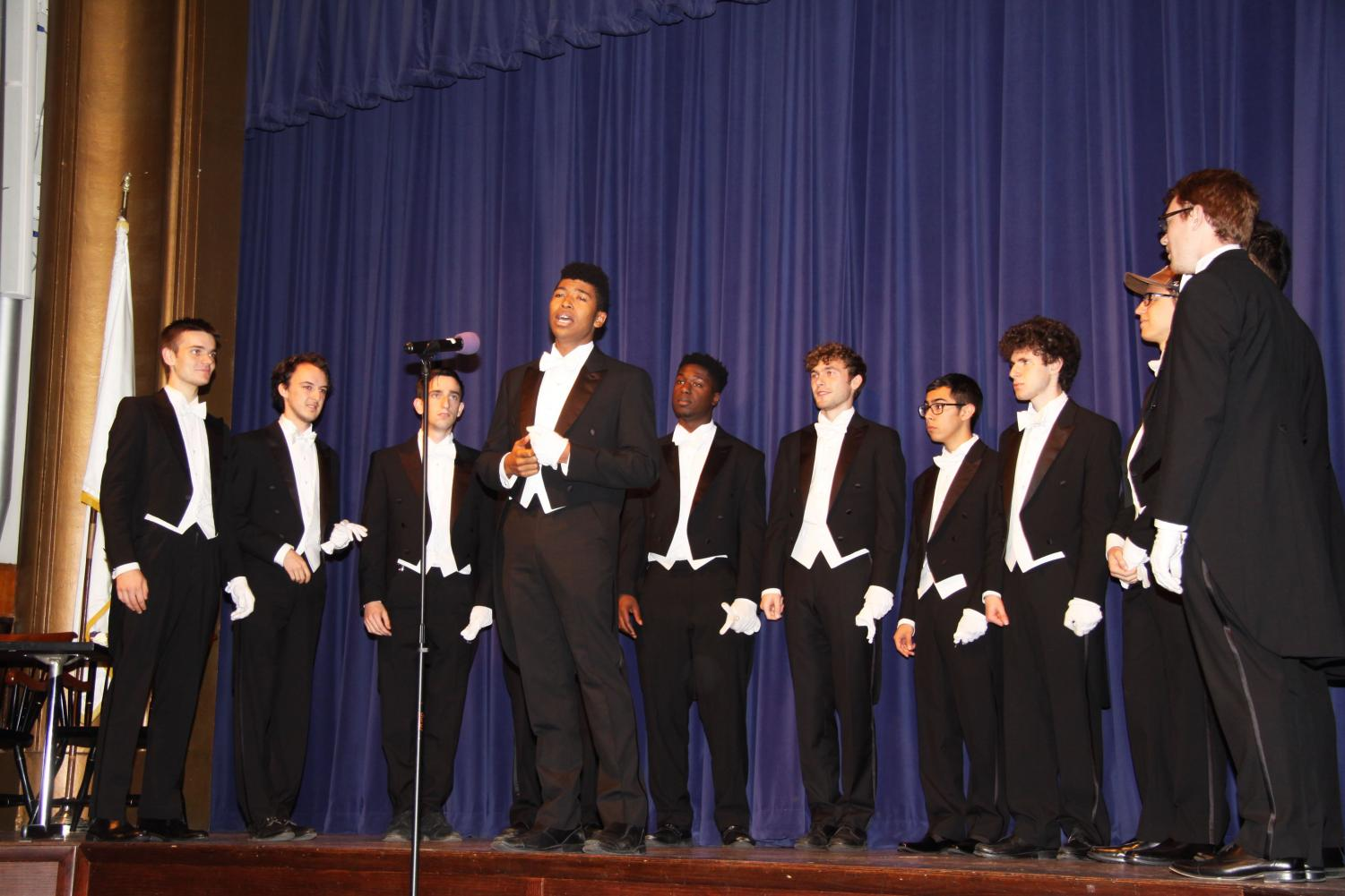 The Whiffenpoofs serenade Poly's upper school students during assembly.