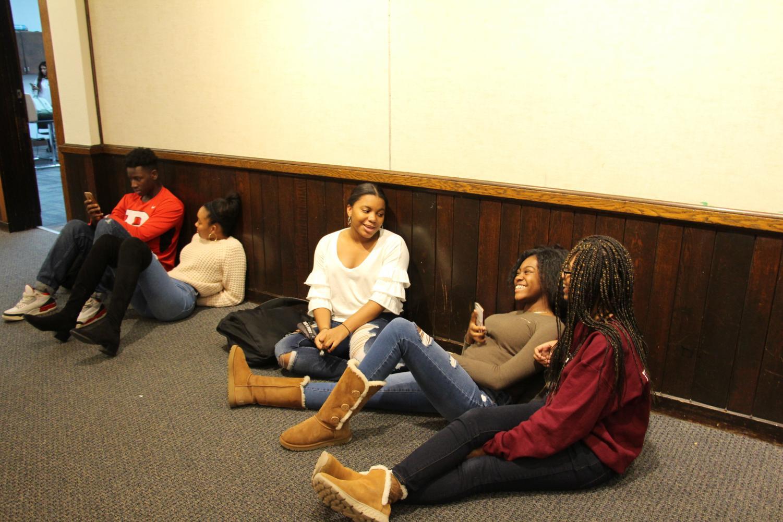 Sophomores Jendayi Leben-Martin, Kayla White and junior Kaelah Pyronneau in the library hallway.