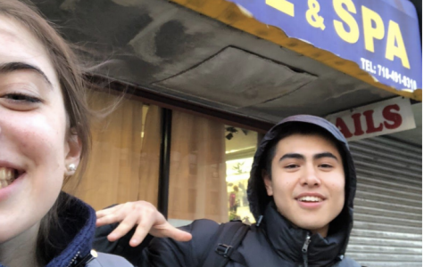 Seniors Ellen Gaffney and Chadd Chang-Venner in front of Sunrise Impression Salon in Bay Ridge.
