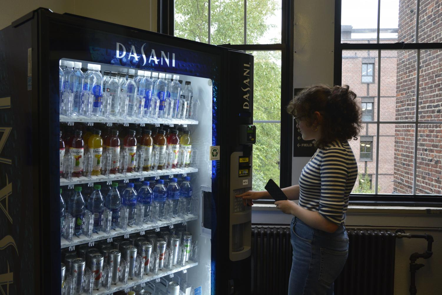 Junior Sasha Khazhinsky contemplates what to buy from a new vending machine.