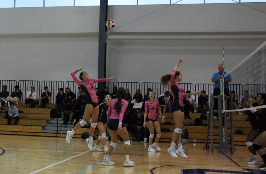 The Girls Varsity Volleyball team dons pink jerseys as they play in support of Breast Cancer Awareness Month.