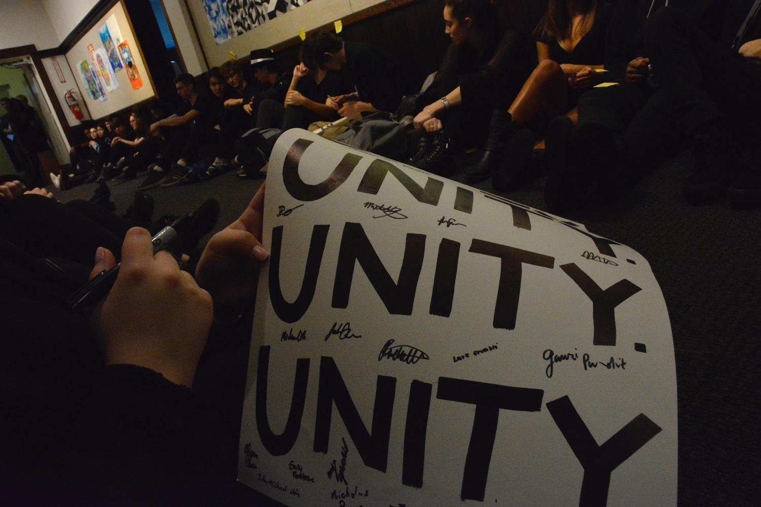During a sit-in on Friday, January 18, Umoja, the affinity group for students of color, asked students sign posters and write notes about what they wanted to see in the school.