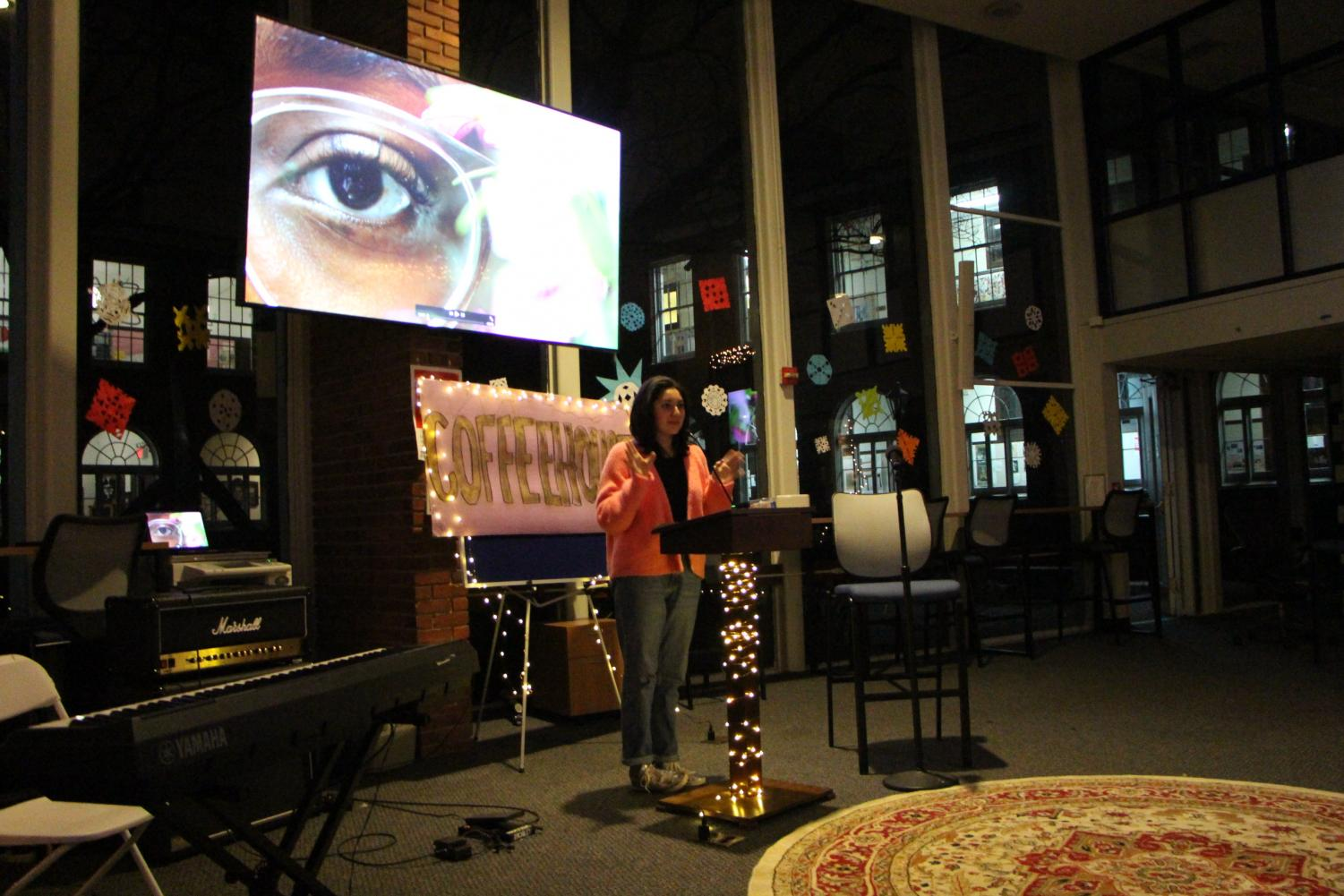 Junior Alexandra Nava-Baltimore presents here photography at the first Coffee House.