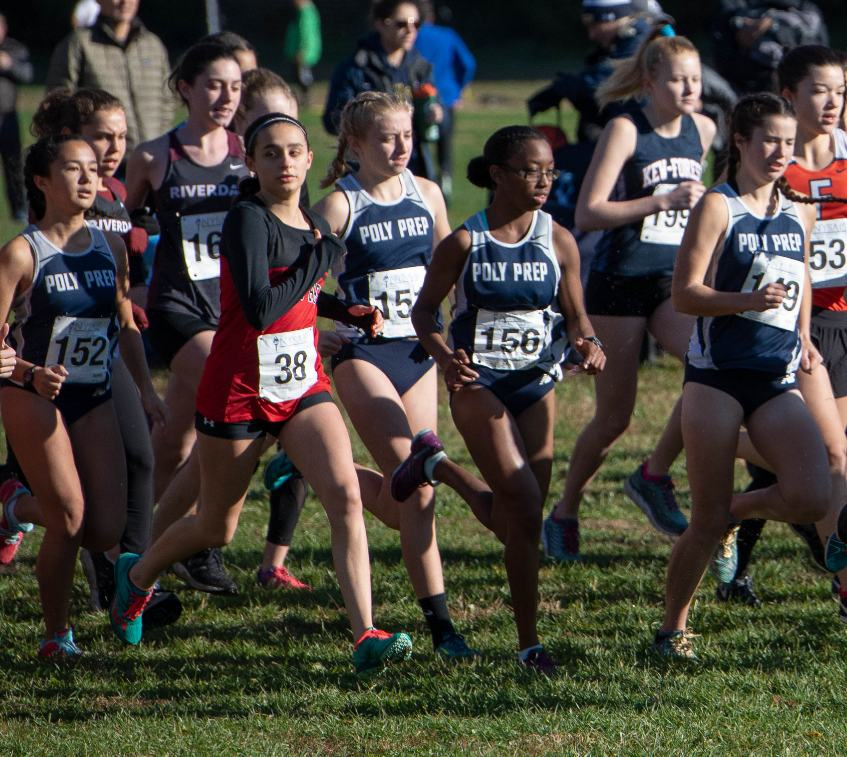 Members of the Cross-Country team burst out of the starting line.