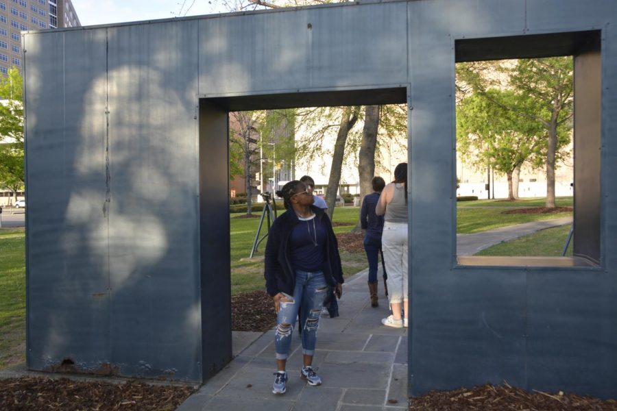 Senior Talisha Ward poses under a statue in Kelly Ingram Park in Birmingham, Alabama.