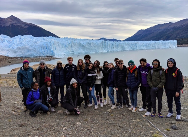 The students on the trip pose in front of the glaciers in Patagonia.