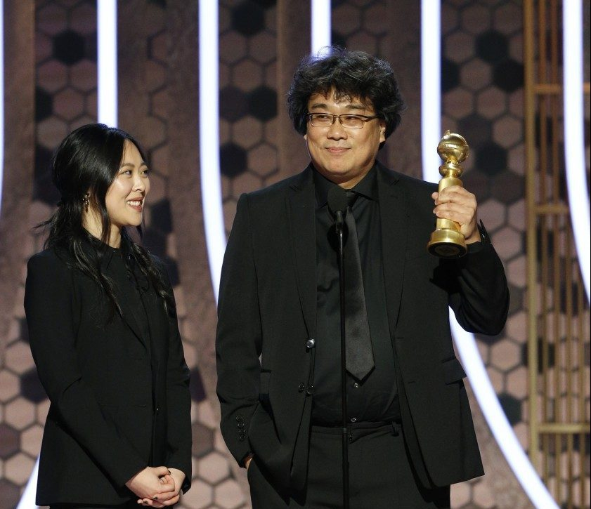 """Parasite"" director Bong Joon Ho, with an interpreter, at the 2020 Golden Globe Awards."